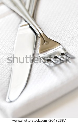 Fork and knife close up on white napkin