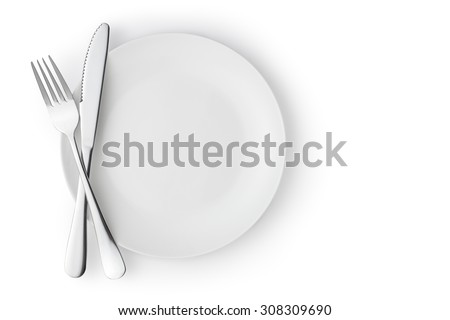 Fork and knife on a empty plate