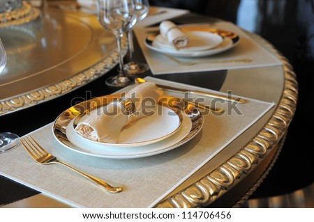 fork and knife on a napkin with plate.