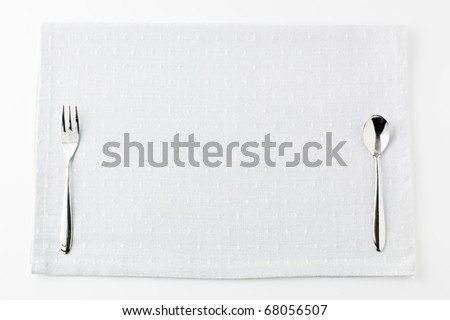 Fork and knife on mat background
