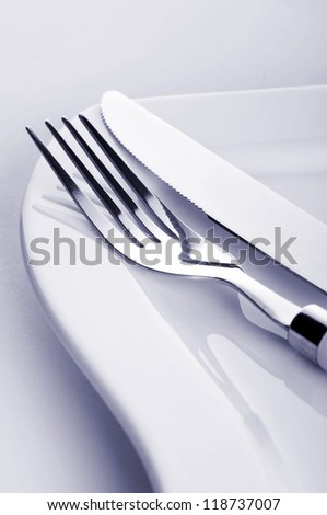 Fork and knife on the plate - stock photo