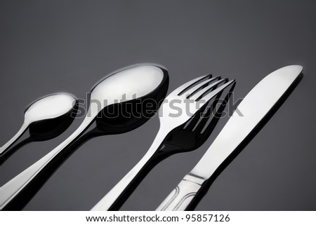 fork and spoon on gray deck
