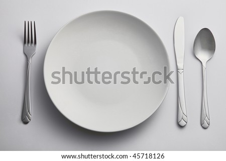 fork and spoon on the side of kitchen plate