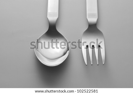 Fork and spoon on white background top view