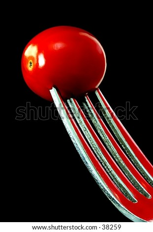 fork and tomato.