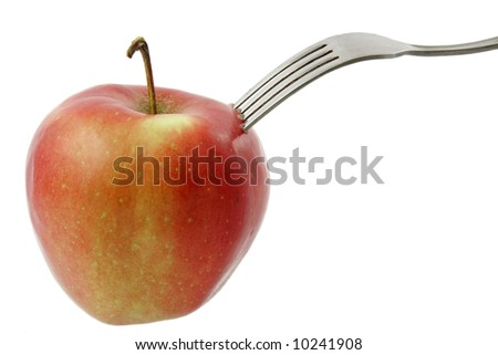 Fork dig into apple isolated on white background