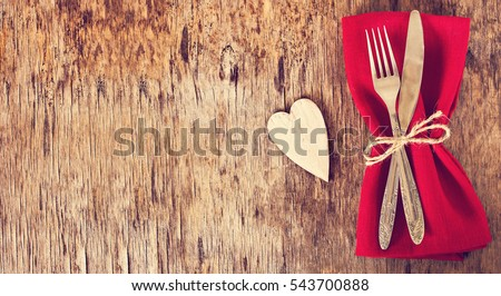 Fork, knife, napkin, heart. Celebrate valentine's day.  Serving, Table decoration Valentine's Day, table set with a decorative heart. Image of dinner on Valentines day. Top view, copy space.
