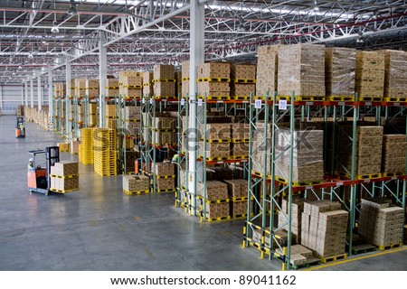 Fork lifter work in big warehouse