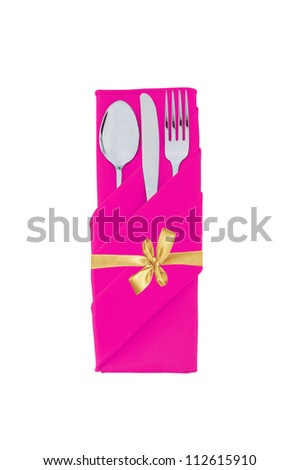 Fork, spoon and knife in pink cloth with golden bow isolated on white background