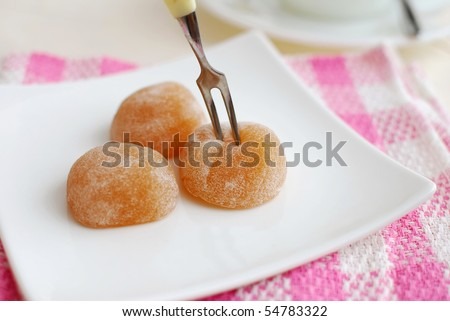 Fork taking sweets on plate. For concepts such as food and beverage, diet and nutrition, and healthy lifestyle.