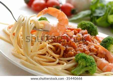 Fork with pasta and shrimp - stock photo