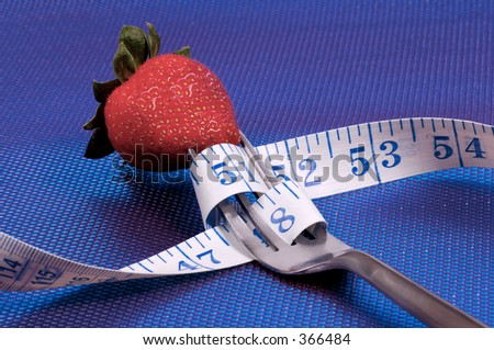 Fork with Tape Measure and a Strawberry. Diet Concept