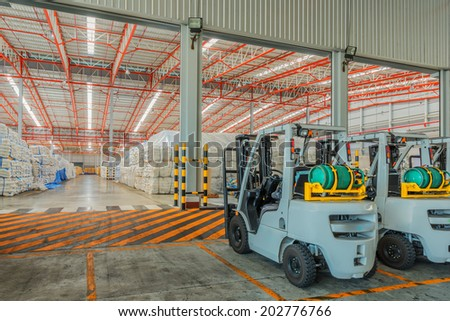 forklift at the large modern warehouse
