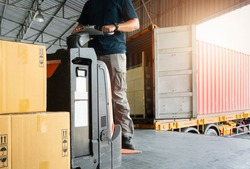Forklift driver loading pallet shipment goods out of a truck, package boxes, road freight transport, warehouse industrial delivery shipment and logistics