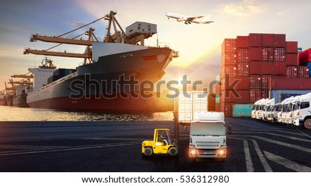 Forklift handling container box loading and Container Cargo freight ship with working crane bridge in shipyard at sunrise for Logistics Import Export background