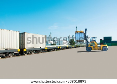 Forklift handling container box loading to train / selective focus. #539018893