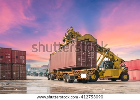 forklift handling the container box packed up transport trucks.