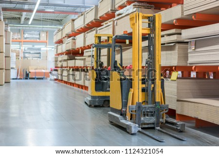 forklift in a construction shop. Construction Materials. Stacking truck in wholesale warehouse #1124321054