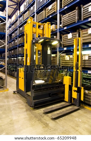 Forklift in warehouse, logistics, delivery of goods in storehouse.