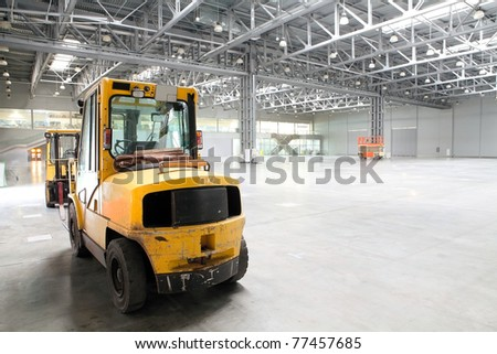 Forklift loader in large modern storehouse