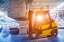 Forklift loader in storage warehouse ship yard. Distribution products. Delivery. Logistics. Transportation. Business background