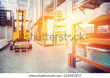 forklift loader pallet Building materials warehouse, logistics concept, construction of houses, loader. high contrast and monochrome color tone.  #621841853