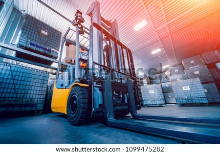 Forklift loader. Pallet stacker truck equipment at warehouse. Background