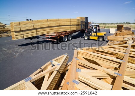 Forklift loading remade trusses onto a trailer