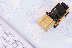 Forklift truck handing cargo shipping container box with keyboard and worldmap background use as online tracking technology of worldwide logistic, shipping, import and export concept.