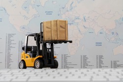 Forklift truck handing cargo shipping container box with worldmap background use as online tracking technology of worldwide logistic, shipping, import and export concept.