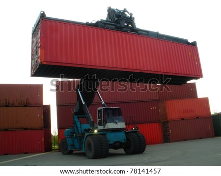 Forklift truck moving containers