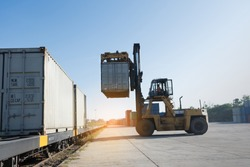 forklift working in the container cargo yard port loading cargo tank to the train, logistic service and transportation.