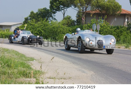 "FORLI', ITALY - MAY 13: An unidentified driver on Jaguar C-type (1951-53) in stage Bologna-Roma of the ""Mille miglia"" historical race for classic cars, on May 13 2011 in Forli', Italy"