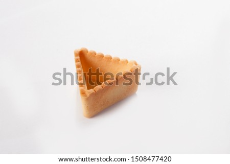 Form from unleavened dough for filling with various fillings. Snack concept. Photo on a white background. Isolated object. View from above. #1508477420