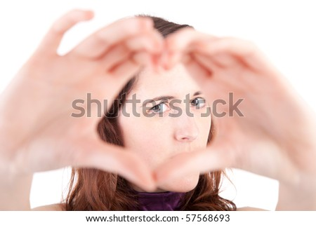 form of heart shaped by the hands of a young woman