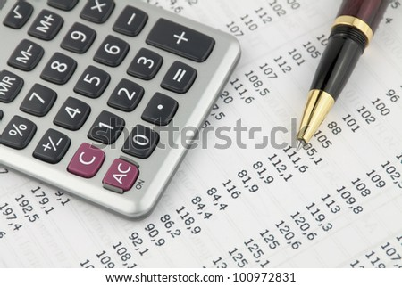 Form with pen and calculator