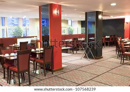 Formal breakfast table setup at hotel restaurant