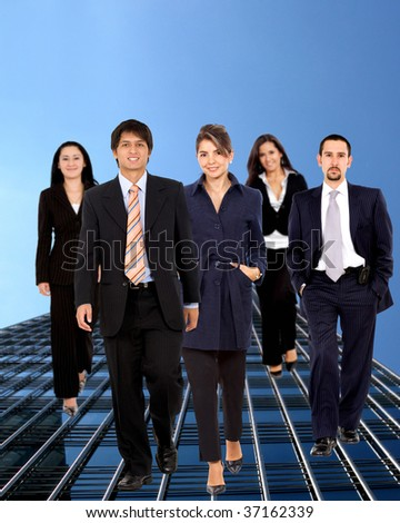 Formal business group outdoors walking and smiling