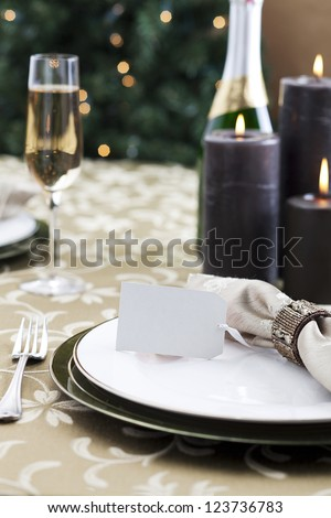 Formal Christmas dinner with light reflection of a Christmas tree