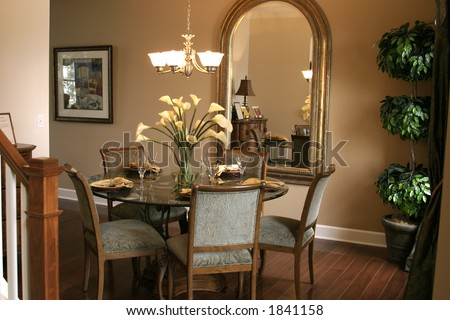 Dining Room on Formal Dining Room With Large Mirror  Plant And Place Setting   Stock