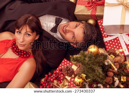 formal dressed fashion people with gift