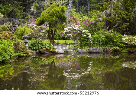 Formal Garden Reflecting in Pond - stock photo