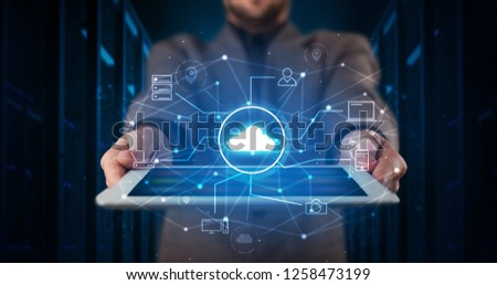 Formal hand in server room with virtual workspace concept