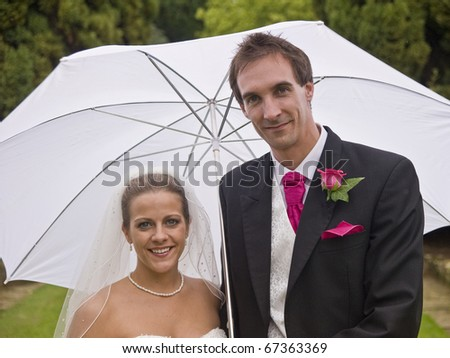 Formal portrait of young attractive bride and groom - stock photo