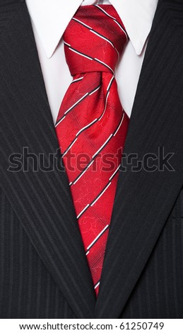 formal suit. white shirt and red necktie