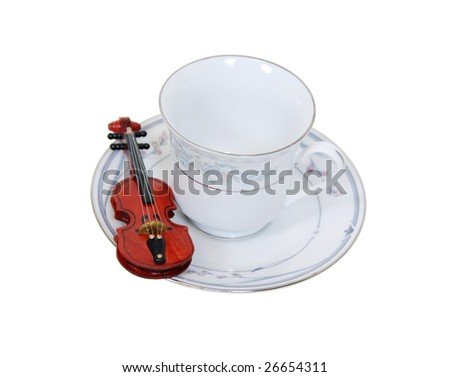 Formal tea cup with a delicate china pattern for drinking tea served with a violin on the side-Path orig size