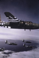 Formation of Douglas A-20's over France during the D-Day invasion in June 1944. They are painted with bold white 'invasion stripe' to ease identification and prevent 'friendly fire' casualties.