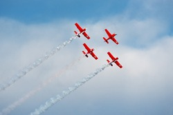 Formation of planes of the blue cloudy sky during the airshow.