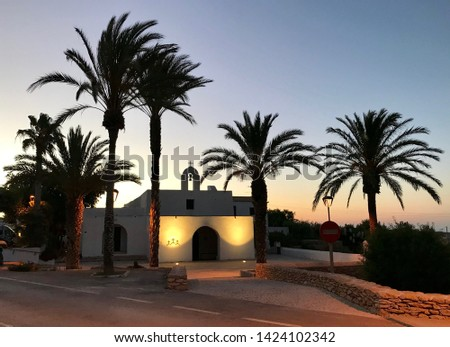Formentera (Baleares, Spain). Sunset on the small church in the Mola's lighthouse zone. Foto stock ©