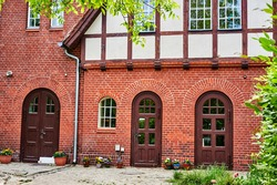 Former historic fire station with a brick facade and half-timbering in Berlin, Germany.